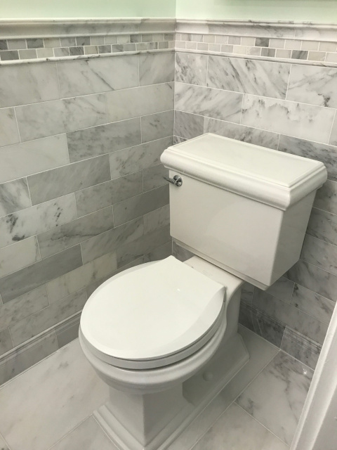 Colonial powder room marble walls and floor